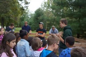 Adam Weber, Austin Mueller, William Horning and Grant Sauder teaching the third graders about livestock.