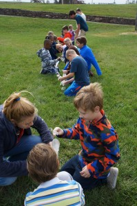ELANCO third graders got to simulate what it would be like to milk a cow using plastic gloves and water.