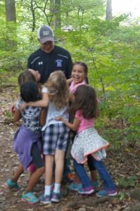 Giving their tour guide, Austin Drescher, a huge thank you hug.