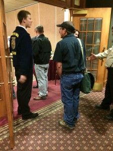 Austin Mueller and Heather Zeiset greeting farmers as they come to breakfast.