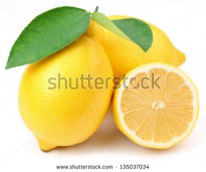 stock-photo-lemons-with-leaves-on-a-white-background-135037034