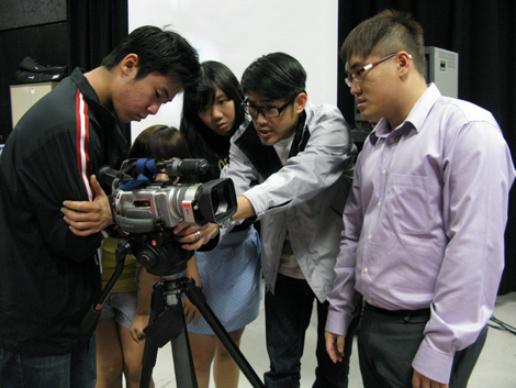 Students getting hands-on experience with video production equipment