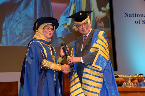 His Excellency Dr Tony Tan Keng Yam, President of the Republic of Singapore and NUS Chancellor confers the Honorary Doctor of Laws on Madam Halimah Yacob, Speaker of the Singapore Parliament