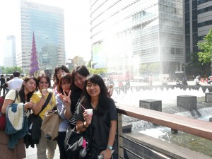 Us with our new friends eating Baskin Robbins ice-cream along Cheonggyecheon in Seoul