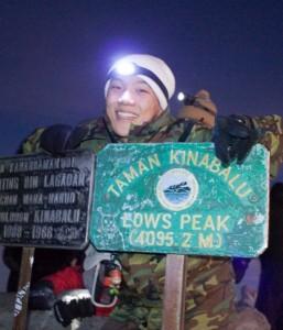 Mr Damon Wong on the summit of Mount Kinabalu