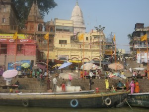 Colourful Scene along the Ganges River: Devotees, Pilgrims and Tourist Boats