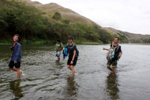 Trekking through the Sigatoka river to get to our site
