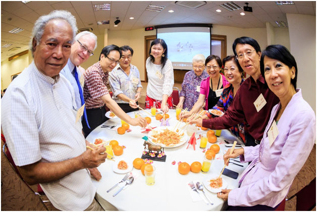 Prof Brenda Yeoh (5th from left) tossing yusheng with alumni, friends and faulty: Emeritus Prof Edwin Thumboo, Prof Michael Sherraden, A/P Su Jui-Lung, Mr Wan, Mrs Ann Wee, Dr Rosaleen Ow, Ms Patricia Gay, Mr Yap Boh Tiong and Mrs Patsy Yap