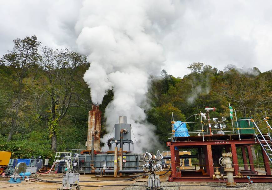 Steam emerges from a well dug to test geothermal power generation in Hokkaido in October 2015. | KYODO