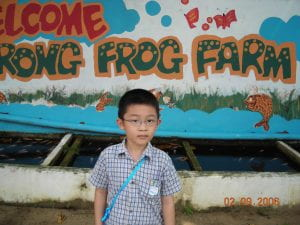 Author aged seven at the Jurong frog farm