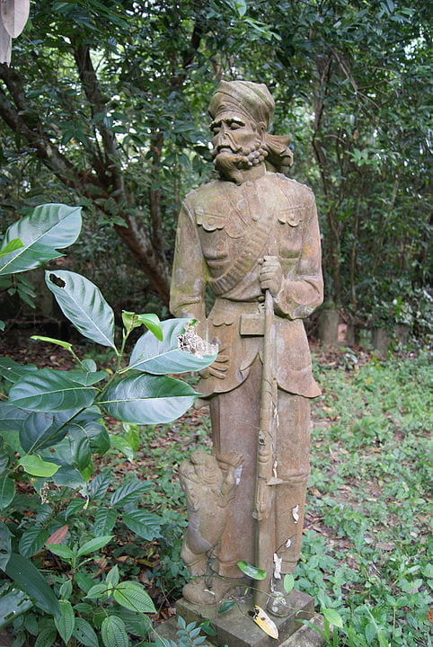 A statue of a sepoy guarding a grave in Bukit Brown Cemetery