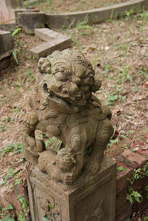 A guardian lion, also known as a stone lion (石狮子 shíshīzi),