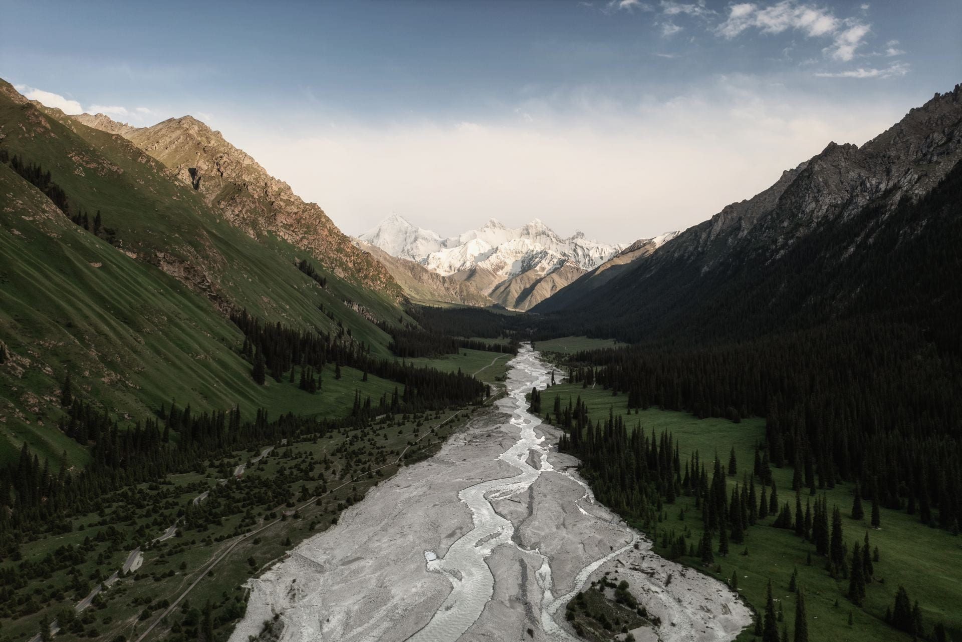 River-and-mountains-with-white-clouds-in-Xinjiang