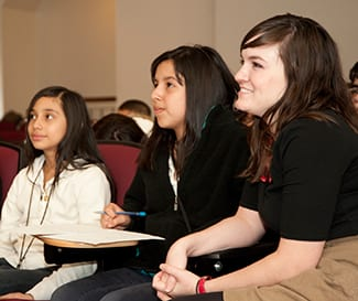 Teacher Cheyenne Rogers '09, right, and Greiner students Ruby Aguilar, left, and Elida Martinez.