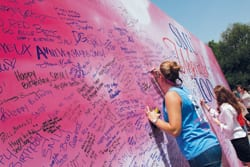 Well-wishers sign a 12-by-20-foot birthday card to SMU.