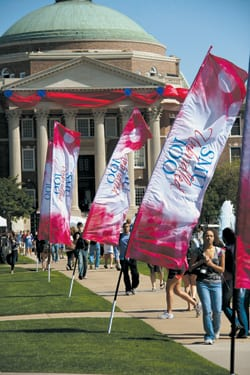 """SMU Unbridled 100"" banners line campus walkways and area streets."