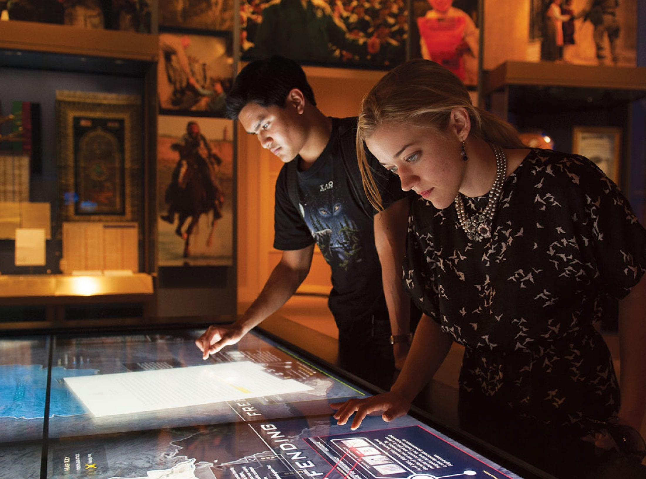 Students explore interactive displays in the Bush Presidential Library and Museum.