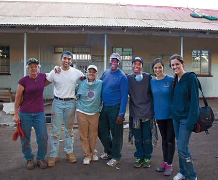 A group of volunteers organized by the George W. Bush Institute helped renovate the cervical cancer screening and treatment center in Livingstone, Zambia, shown above. Among the volunteers were (left to right) Pam Jackson, SMU junior Prithvi Rudrappa, Carolyn Creekmore, Professor Eric G. Bing, SMU sophomores Tyrell Russell and Melanie Enriquez, and SMU junior Katie Bernet.