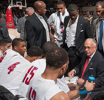 Coach Larry Brown strategizes with players during a break in the Cal game, which SMU won 67-65.