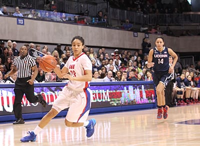 Keena Mays takes the ball down the court at Moody Coliseum for the SMU women in the game against the University of Connecticut on February 25 in front of a record crowd of 4,091 fans. The SMU women's basketball team advanced to the second round of the WNIT.
