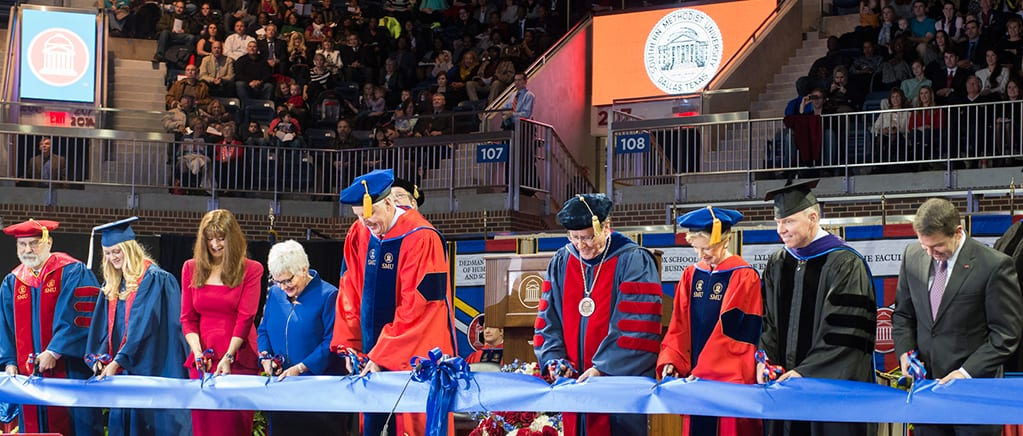 Participating in the ribbon cutting for a re-opened Moody Coliseum at the December 21 graduation ceremony were (from left) Provost Paul Ludden; student Morgan Rose Beckwith '13; donors Frances Moody-Dahlberg '92 and Carolyn Miller and SMU Trustee David Miller '72, '73; President R. Gerald Turner; Board of Trustees Chair Caren Prothro; Brad Cheves, vice president for Development and External Affairs; and Athletics Director Rick Hart.