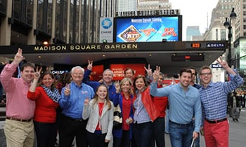 Mustang fans flash the pony ears in front of Madison Square Garden before the NIT Final game.