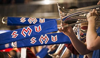 The Mustang Band worked its magic at Moody Coliseum and the NIT Finals.