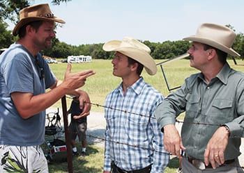 Will Wallace '89 (left) with actors Glen Powell (center) and Bill Paxton on the set of Red Wing.
