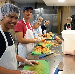 Students volunteers serve with nonprofits in the United States and abroad over spring break through SMU's Alternative Breaks program. Last year, this group of students helped a New York City organization prepare meals for delivery to seriously ill people. SMU alumni are invited to