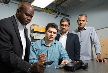 An interdisciplinary research team – (from left) Eric G. Bing, Nicholas Saulnier, Dinesh Rajan and Prasanna Rangarajan – has developed a smart-phone based screening system for early cervical cancer detection that is being test in Zambia.