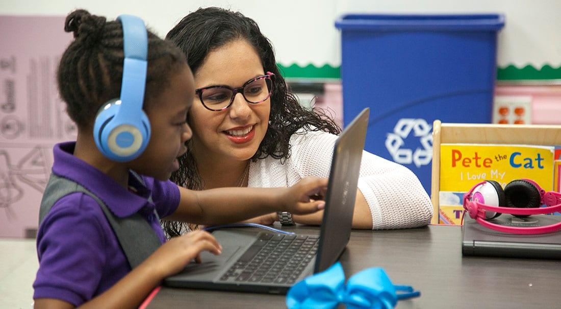 Nancy Bernardino helping a student.