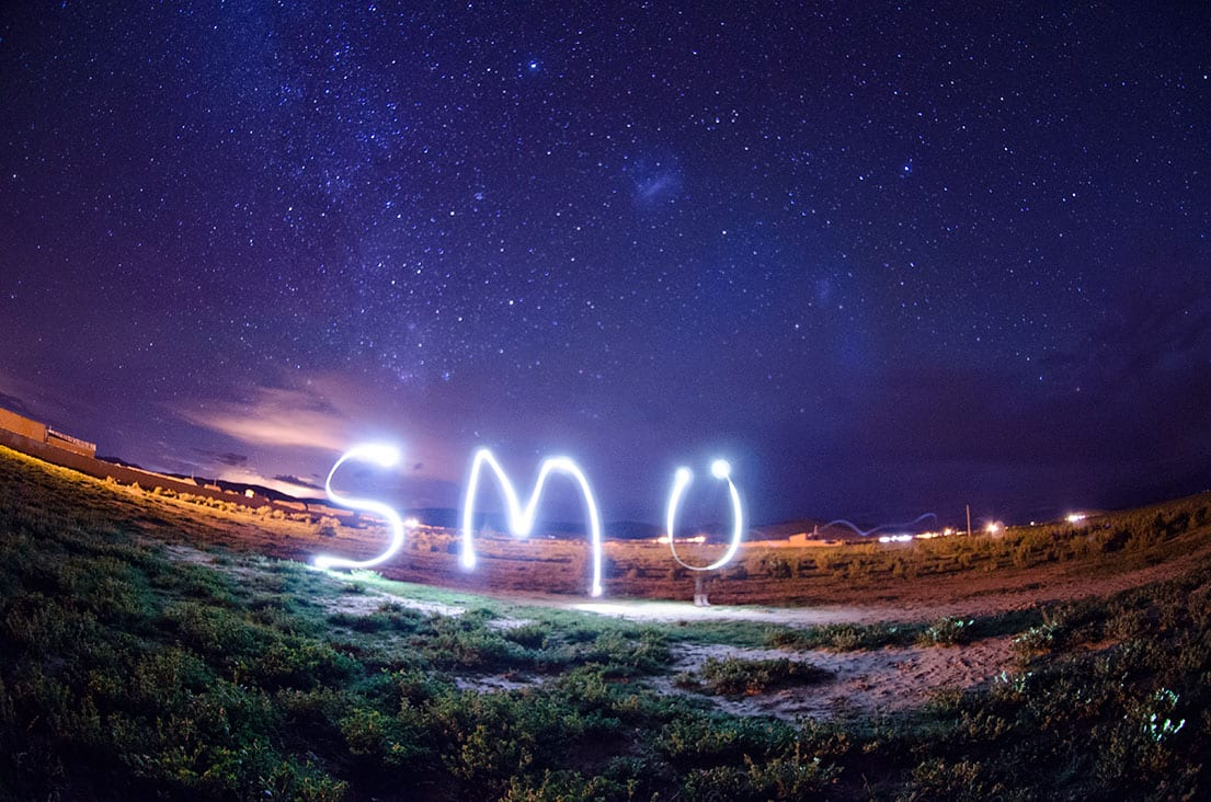 SMU spelled out in light by SMU's Engineers Without Borders in Bolivia.
