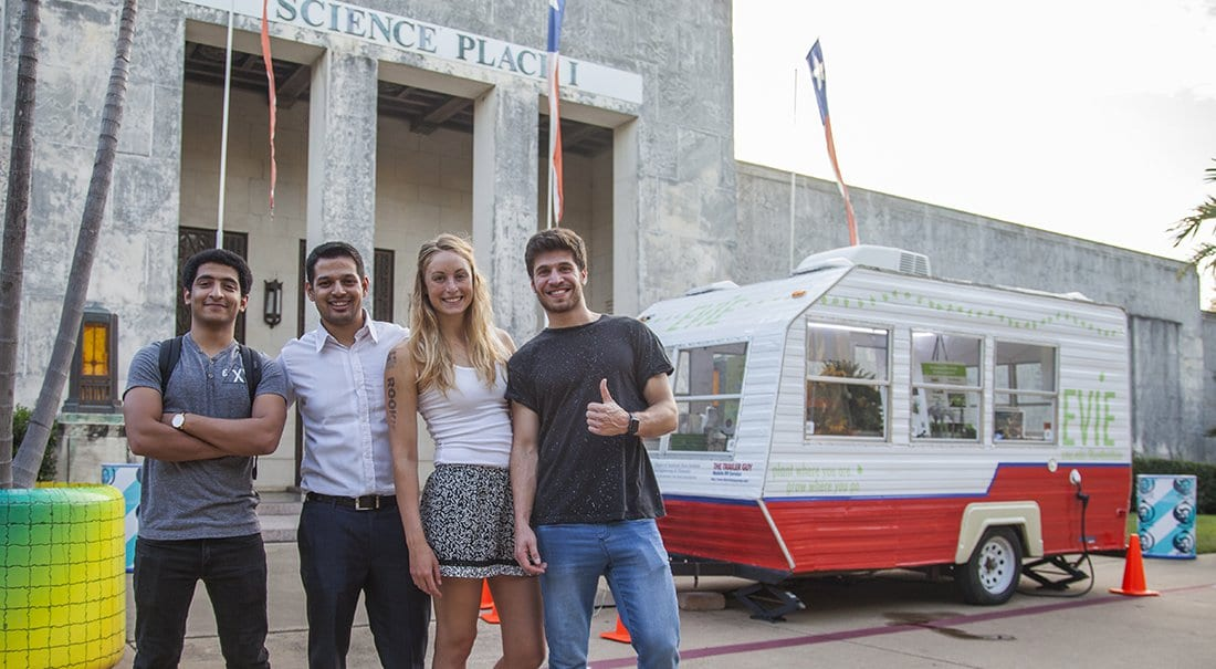 Adrienn Santa '18 and her fellow undergraduate researchers with Evie, the mobile greenhouse.