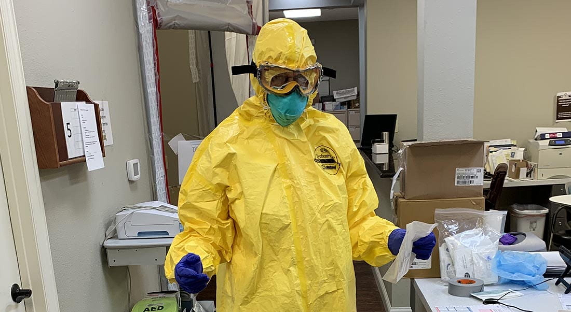 Barbara Baxter of the Agape Clinic wearing personal protective equipment to treat suspected COVID-19 case.