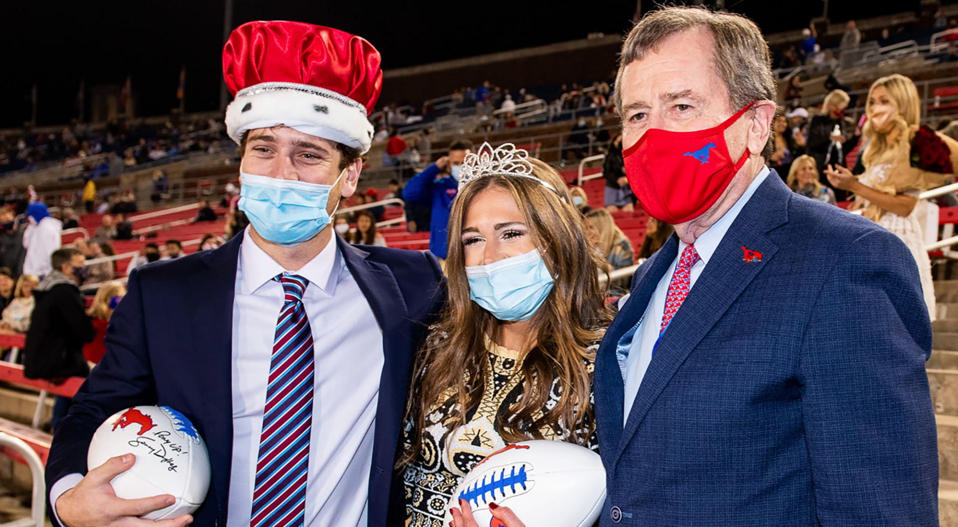 2020 Homecoming King and Queen with SMU President R. Gerald Turner.