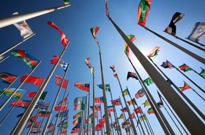 Stock photo of flags of many nations from a low angle