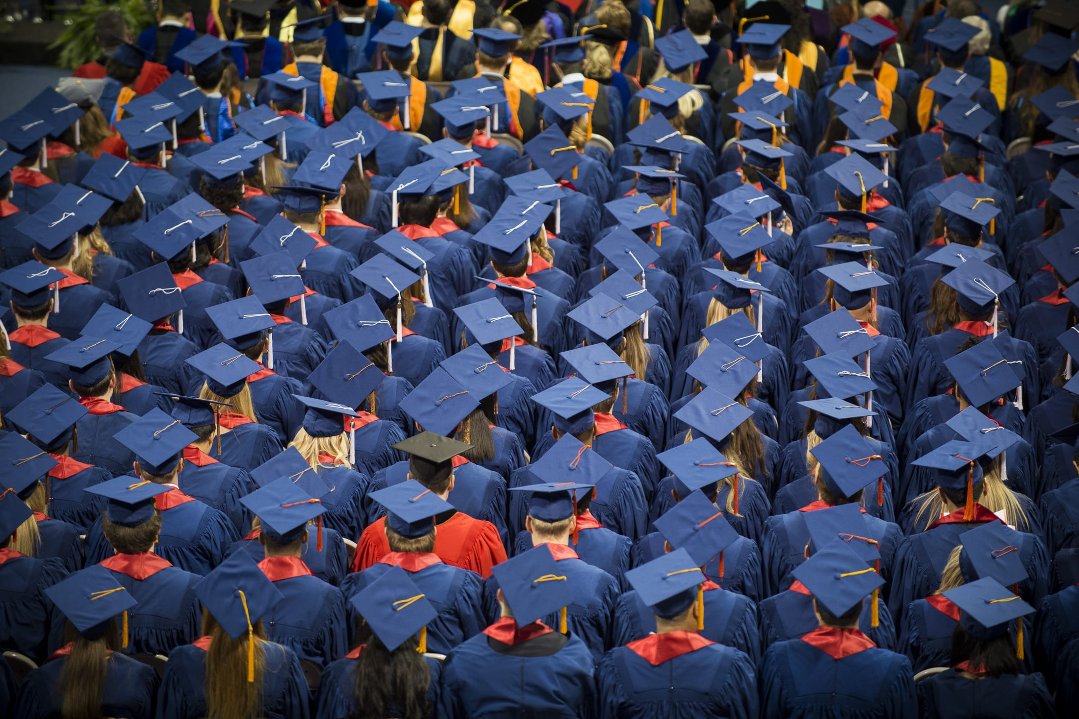 Blue mortarboards at SMU December Commencement 2013. Photo by Guy Rogers