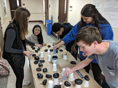 Students paint rocks for Dark Matter Day 2017 at SMU