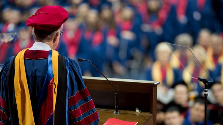 SMU May Commencement Convocation 2017, Francis Collins at the podium, 2018 events illustration