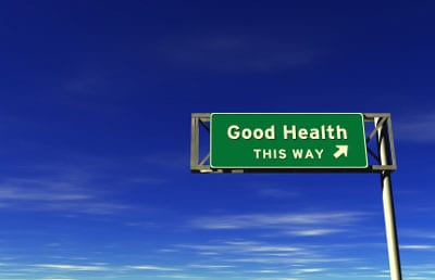 Stock image of 'Good Health, This Way' freeway sign