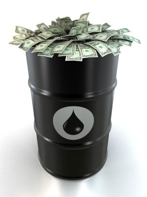 Stock image of oil barrel stuffed with dollars