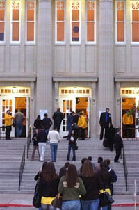 SMU students on McFarlin Auditorium steps at dusk