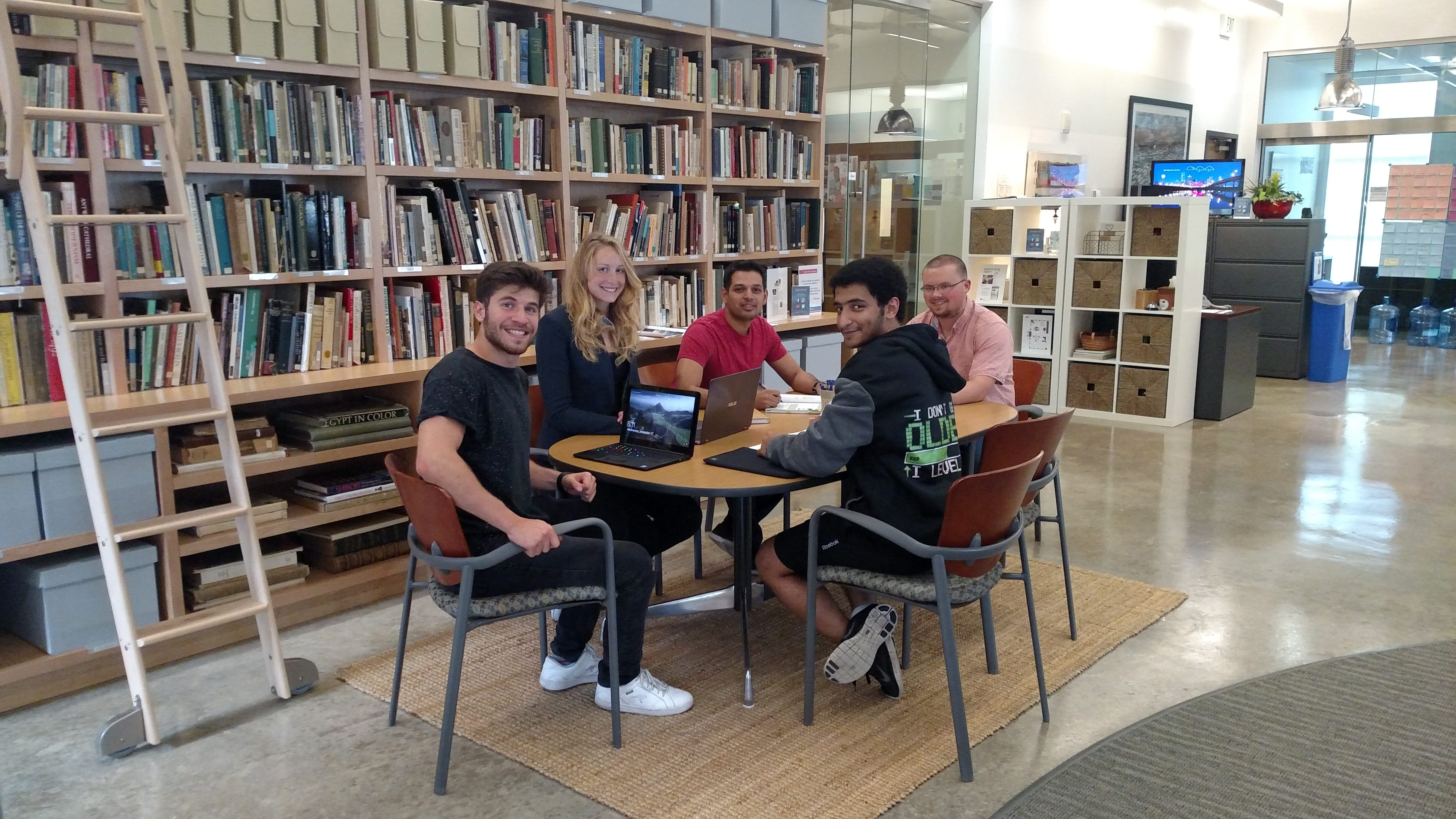 Students meeting in the Hunt Institute. Engineers at SMU. Senior Design Project. Evie. Cooling system.