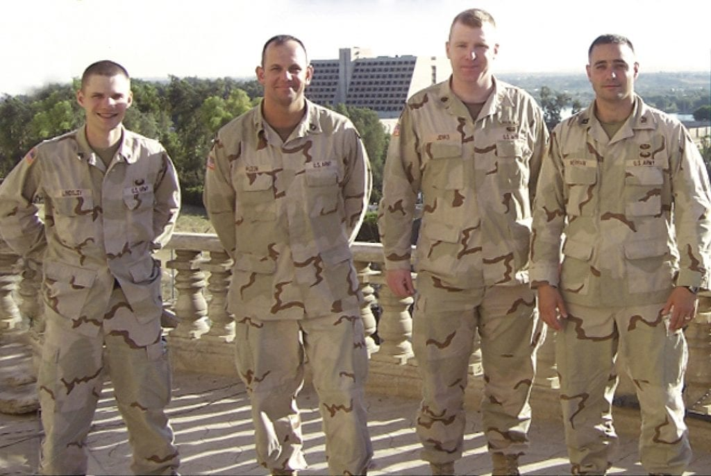 Lt. Col. Chris Jenks, second from right, with his team in Mosul, Iraq.