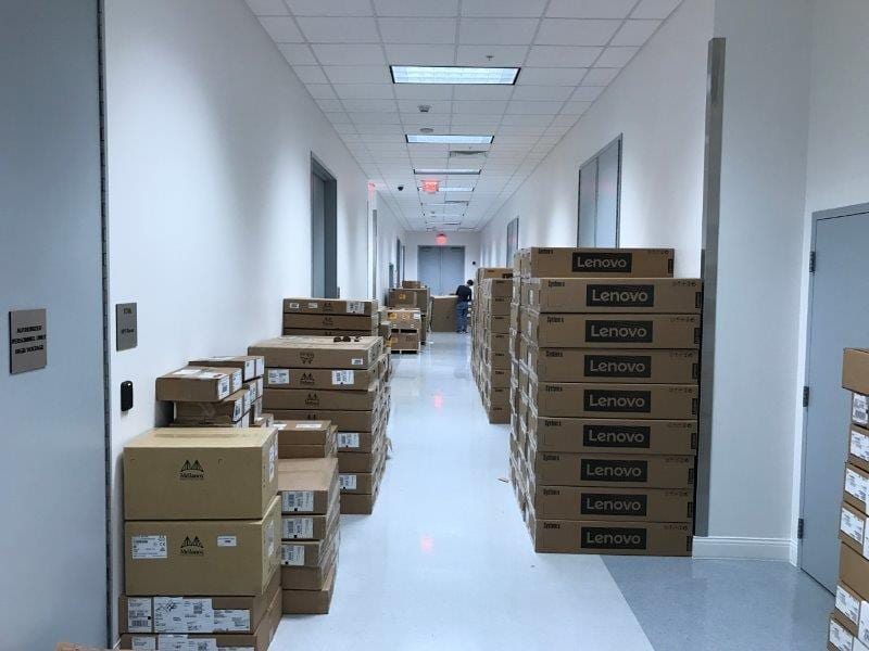 Over 90 pallets of equipment were unloaded, inventoried, sorted into groups and staged for assembly.
