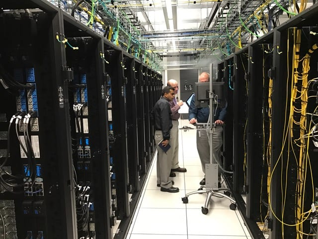 Amit Kumar and Richard England work with vendor to install the cluster management software that will improve operational effectiveness of the system.