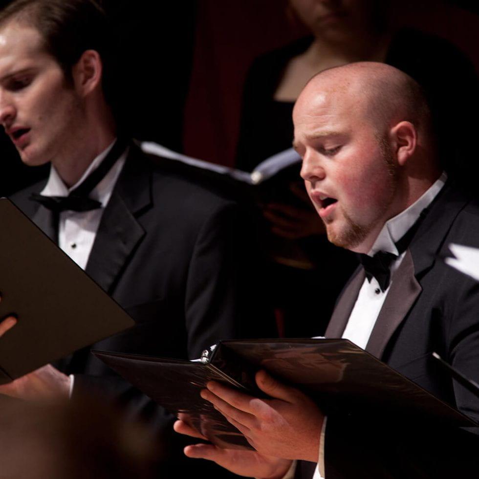 Two choir men singing