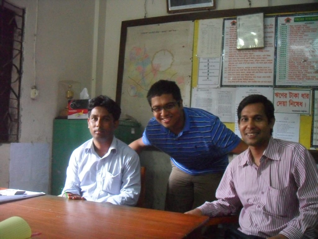 Rahfin with Grameen Bank employees in Bangladesh