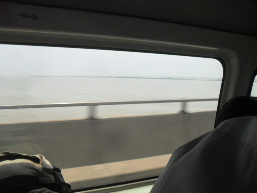 Rahfin crossing the Jumana bridge in Bangladesh