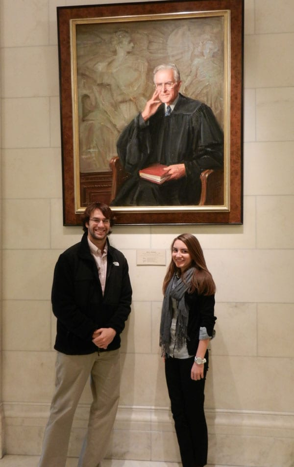 Eric and Taylor with Justice Blackmun's portrait